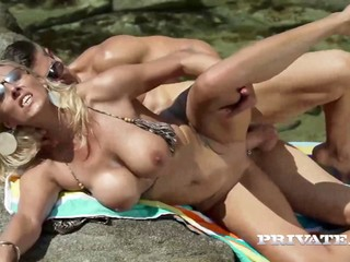Busty cougar lures for big-cock pray on the beach