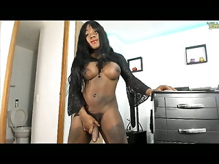 Busty ebony shemale with big cock